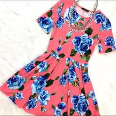 Pink & Blue Floral Short Sleeve Skater A great summer look! Short sleeves, tailored bodice and a-line skirt, flatters nearly EVERY figure! Grab this cutie and your look is half done! Please note sizing: Small 2-4, Medium 4-6, Large 8-10. ChicBirdie Dresses