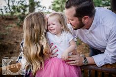 Mom sharing a secret with little girl at this family session at Baxter Gardens in Fountain City by Knoxville Wedding Photographer, Amanda May Photos