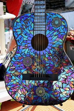 Stained glass guitar: A one-of-a-kind piece of stunning stained glass art. If I played guitar-this bad boy would be mine
