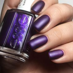 Step across the line into a world of sensuous seduction. Juicy and bold, this deep purple nail polish -- essie 'sexy divide' with hints of shimmer is just irresistible. Top it off with 'matte about you' top coat for a mattified finish. Shop this shade here: http://www.essie.com/Colors/plums/sexy-divide.aspx
