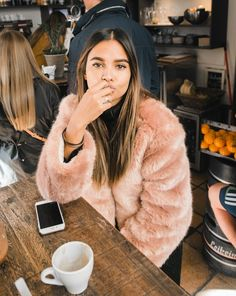 This pink faux fur coat will brighten up your winter wardrobe for good