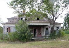 just taking this picture creeped me out. this house use to be behind a dairy queen that i use stopped at going to & from houston. they finally tore it down.  fairfield, texas