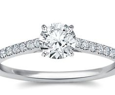 Love. Better with a princess cut and a bigger rock. :)