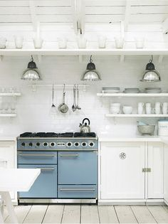 Love the aesthetic in this kitchen, BUT 1. Where is the ventilation for the range? 2. Open shelves by the range mean that everything on them gets covered in a thin layer of grease. hmmm