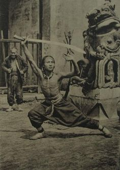 """A Shanghai ""sword dancer"" demonstrates some forms. Again, taken in the 1930s."""