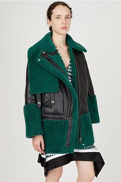 19 Stylish Winter Coats That Are Actually Warm #refinery29  http://www.refinery29.com/warm-dressy-coats#slide-8  An oversized moto with a mossy invasion....