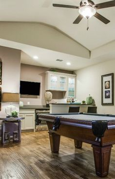 Invite your friends to enjoy a drink and a game of #billiards in your #upstairs #mancave with high #ceilings, #hardwood #flooring and a built-in #bar area. #pooltable #gameroom #dreamhome #interiordesign