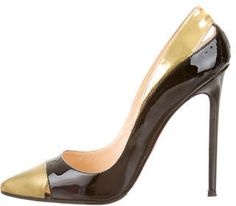 Black patent leather Christian Louboutin pointed-toe Pigalle pumps with tonal stitching, gold-tone metallic cap-toes, cutout accents at sides and covered heels.