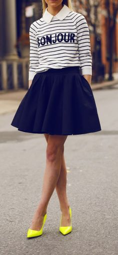 Navy skirt with a stripe long sleeve over a collar blouse. Pop of color yellow pumps to top it off!
