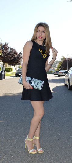 Black dress outfit doesn't have to be boring. Add a neutral or bold accessory and your look is complete.