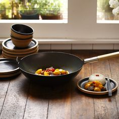 Wok A truly authentic wok designed for use in the modern home, authenticity is the keyword for this kitchen necessity. Strong and durable, this Wok conducts heat qu...
