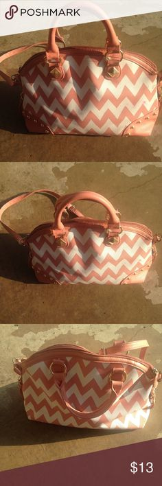 Chevron purse pink handbag big purse Looking for a designer bag without the price? This purse is for you- pink and white chevron with gold trim. Good used condition! Strap can be removed to carry or left on to put around shoulder. 15 inches across- 11 inches from top to bottom. No wear or tear. Clean insides. Lots of room- it held all of my stuff lol! Zipper pouch on inside and two pockets Bags