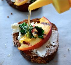 Toast with cheese, fruit, basil and honey