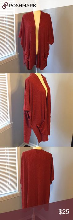 Candies burnt orange long open cardigan Cute long open cardigan with slouchy pockets sides with button closures great movement with walking. Flay away look Candie's Sweaters Cardigans