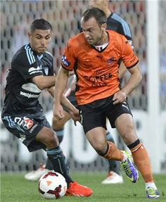 Ali Abbas shadows Ivan Franic who scored Brisbane Roar's second goal of the night as they went on to win 4-0 at home over Sydney in Rd2.