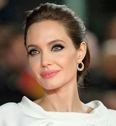 Take a look at the best Angelina Jolie hairstyles in the photos below and get ideas for your cute outfits! She looks like an Angel who just gracefully slid down to earth. If you have healthy beautiful hair try this… Continue Reading → Angelina Jolie Makeup, Angelina Joile, Angelina Jolie Pictures, Angelina Jolie Photos, 50 Hair, Brad Pitt, Beautiful Celebrities, Beauty Women, Ideias Fashion