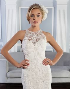 Beaded Soutache lace fit and flare sleeveless gown with jewel neckline  and an open illusion back. The gown is finished by a side zipper and a  chapel length train.