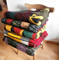 some colourful vintage blankets on a chair