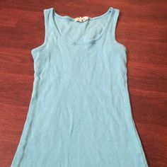 Tank top Blue tank top size medium and can fit a small as it is fitted. It has been worn several times but in great condition. Derek Heart Tops Tank Tops