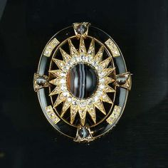 A late Victorian enamel, banded agate and diamond brooch/pendant,
