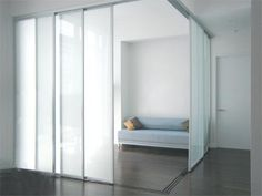 The Sliding Door Company silver finish room divider, solo design and frosted glass. #the_sliding_door_company