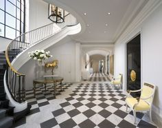Love the checkerboard floors in this home....the touches of soft yellow are perfect!
