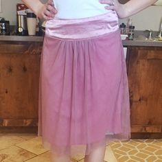 Rose Pink tulle skirt. Very flattering and comfortable. Hits right at the knees. Tulle with lining underneath. Top band shows a few signs of wear (small snags). Size small but runs big. Downeast Basics Skirts Midi