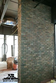 the clay brick accent wall is a nice accent feature in the restaurant decor