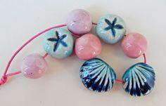 Stoneware and porcelain ,8 beads . By Mª Carmen Rodriguez ( Majoyoal ) https://www.facebook.com/groups/CeramicArtBeadMarket/