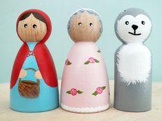 Handpainted wooden peg doll set.