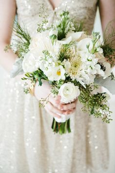 All white bouquet + greenery // photo by Angela & Evan Photography