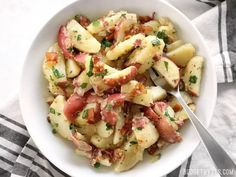 German Potato Salad is tossed in a deliciously sweet and tangy mayo-free dressing with bacon, mustard, and vinegar. Perfect for potlucks! German Potatoes, Party Dishes, Potato Dishes, Bacon Recipes, Food Trends, Easy Dinner Recipes, Dinner Ideas, Food Network Recipes, Potato Salad