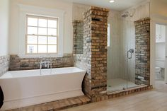 Love this bathroom with brick and wood tiles in the shower.