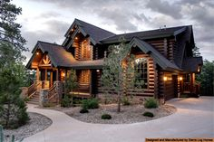 Love log homes. This is what I want my log cabin winter home to look like.