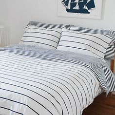 Sailor + Regatta Blue Striped Duvet Covers | Modern Bedding | Unison | Nautical stripes really anchor a room. The proof is this modern duvet cover. Flip it depending on your sea-loving mood: There are cool, fine regatta stripes on one side, and dense graphic sailor bands on the other. It's comfy cotton bedding at its best.