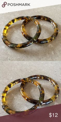 Pair of Tortoise Shell style Bangles This pair of Tortoise shell style bangles are very well done acrylic pieces. Swirls of topaz, brown & off white make it pop. Great condition. Fun for all seasons. Jewelry Bracelets