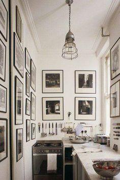 Tiny kitchen. Made striking through a simple black, white and chrome colour palette