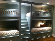 Double bunk beds in our new basement bunk room. Fun for sleepovers and great for out of town guests. Mom and Dad on the bottom bunks and their two kids on the top! There is a niche at the top end of each bunk with an individual light switch and outlet for charging electronics overnight.