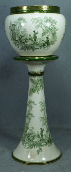 """2 part Doulton Burslem Watteau pattern jardiniere and pedestal, light green printed design, spider in body of top, general crazing, 31 1/2"""" tall"""