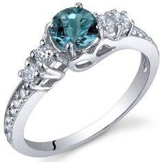 Revoni bezaubernder Ring aus Sterling Silber mit London Blau Topas-0.50 Karat: Amazon.de: Schmuck