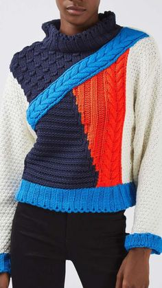 Crazy colorblock and cables sweater