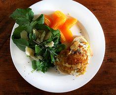 egg on toast with arugula and oranges