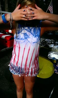 DIY 4th of July Beaded Shirt - Cut out some star shaped pieces and lightly spray around them with fabric spray paint. Fringe the bottom and add beads.