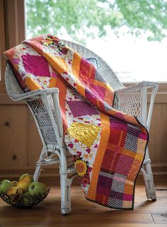 Perk up dreary winter days by making a quilt with bright, cheery fabrics. The multicolor plaid fabric makes this quilt look like you spent hours piecing the borders.