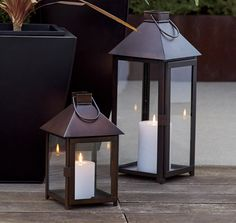 The traditional lantern scales up and streamlines with a warm bronze finish that looks great in the home or outside on the patio. Clean and classic styling includes glass panels, a hinged door, and hanging handle. Pair with the coordinating large lantern for a multi-level approach to candlelight.