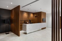 Our task was to create comfortable and functional modern public space for dental clinic. Clinic should look more like a SPA than a medical institution. We interwove cozy decorations with cold and simple medical interiors with unique digital dental equipm… Hospital Reception, Dental Reception, Office Reception Design, Reception Desks, Reception Counter, Medical Office Design, Dental Office Design, Design Offices, Healthcare Design