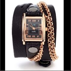 """La Mer Wrap Around Watch Extra-long soft Black Italian 1/2"""" leather strap topped with a second layer of Black 1/4"""" leather. 22"""" long, .5"""" wide strap and .25"""" top layer on strap, IP Rose Gold Plated rivets and La Mer Collections' Signature Rose Gold Square Watch Case with Black Dial, .875"""" wide Watch case, Japanese movement, buckle closure. Rose Gold Chain. Nickel Free. Comes with box. BATTERY FOR WATCH NEEDS TO BE REPLACED. La Mer Accessories Watches"""