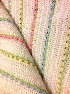 "Modified ""flowers in a row"" Baby blanket. Soft Pastel colours in baby acrylic fingering yarn. The pattern forms tiny little tulips amongst a background of double crochet."