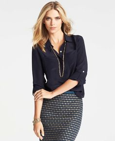 Chic Professional Woman Work Outfit. silk button down blouse with long slender necklace over