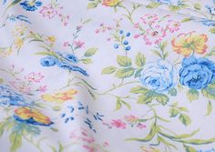 White Cotton With Blue Yellow Pink Flower Fabric by fabricmade